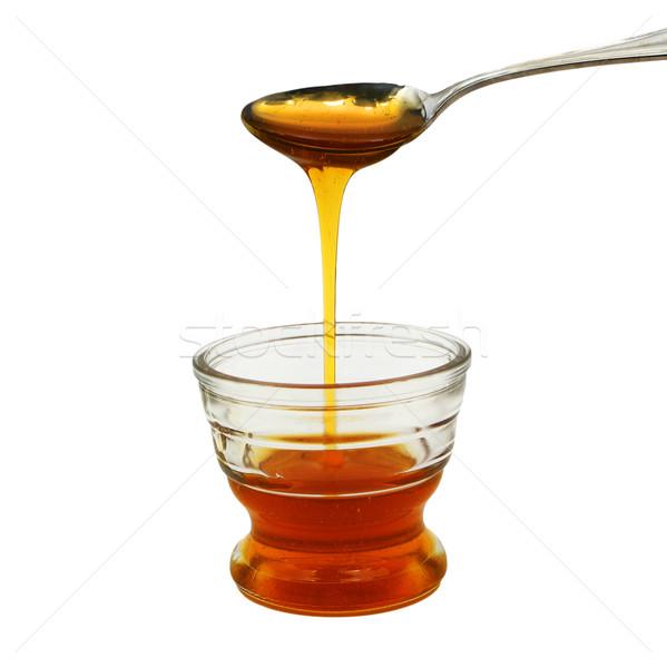 honey pouring into small glass bowl Stock photo © bobkeenan
