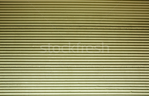 Green tinted corrugated wall Stock photo © bobkeenan