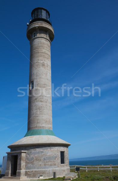 Ponto arena farol ver grama blue sky Foto stock © bobkeenan