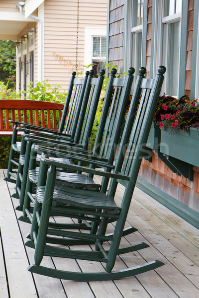 Four green rocking chairs Stock photo © bobkeenan