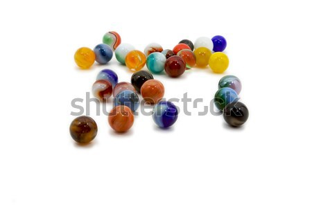 Marbles spread on white Stock photo © bobkeenan