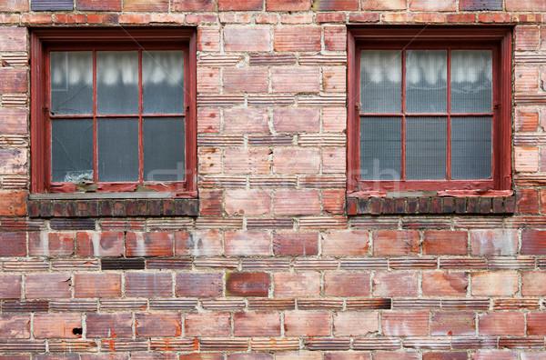 Ugly Old red brick wall windows Stock photo © bobkeenan