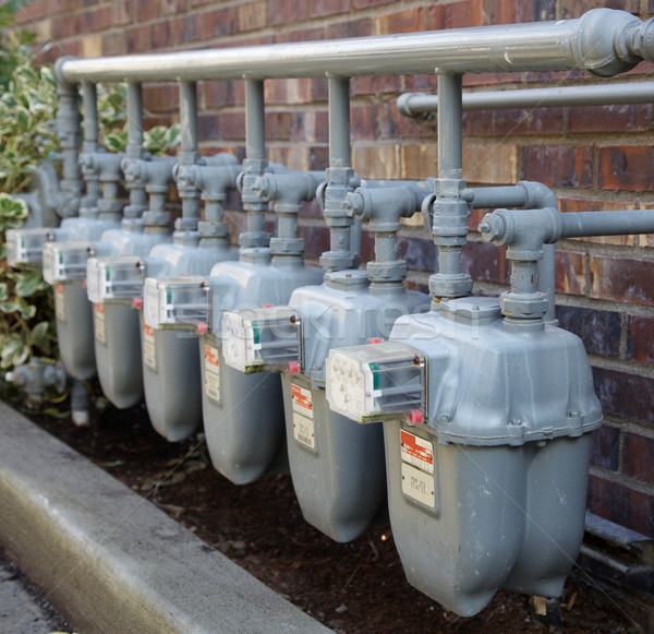 Row of gas meters with full manifolding Stock photo © bobkeenan
