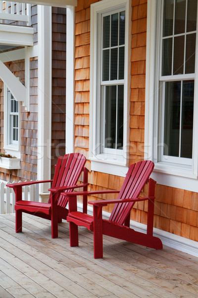 Two red Adirondack chairs Stock photo © bobkeenan