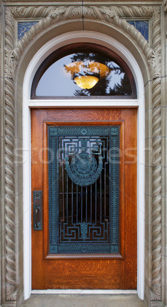 Wood and ornate grill door Stock photo © bobkeenan