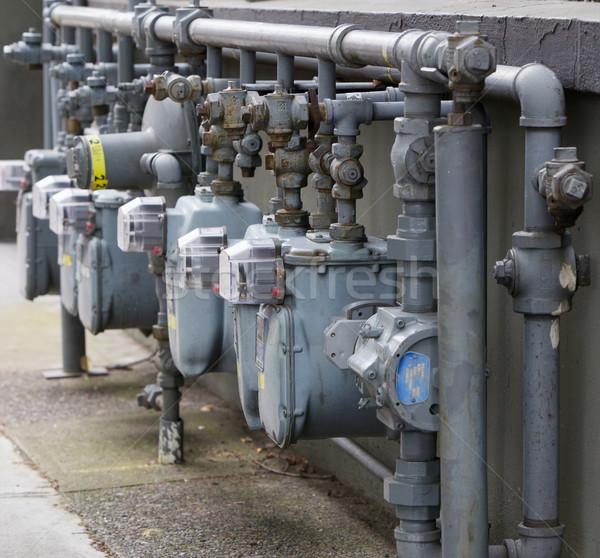 Gas meter row at angle Stock photo © bobkeenan