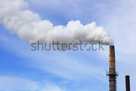 Fumée ciel bleu vieux usine blanche Photo stock © bobkeenan