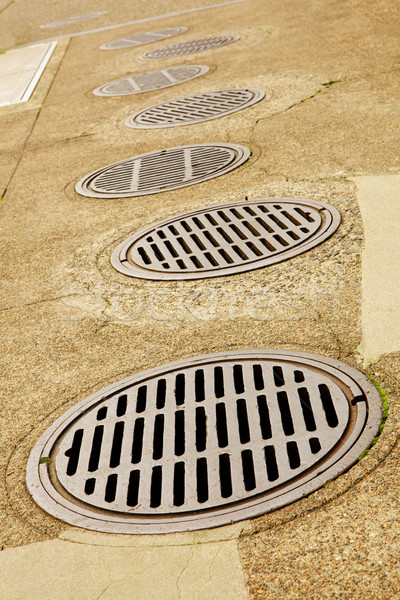 Line up of Sewer Drains Stock photo © bobkeenan