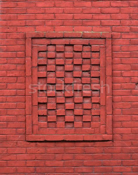 Red Brick wall alternating depth Stock photo © bobkeenan