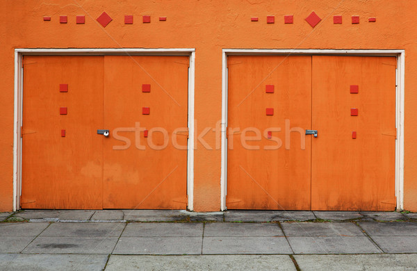 Two Orange Garage Doors Stock photo © bobkeenan