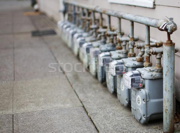 Single Row of gas meters Focus Stock photo © bobkeenan
