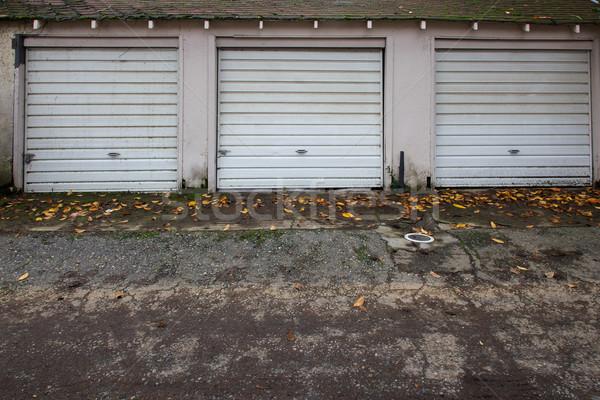 Drie oude garage deuren witte metaal Stockfoto © bobkeenan