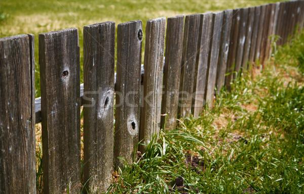 Dimishing wood fence Stock photo © bobkeenan