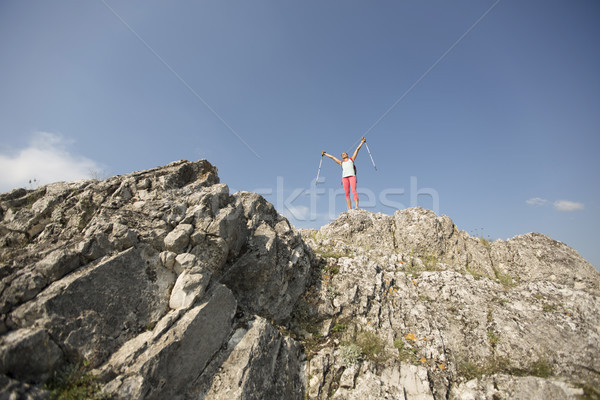 Successful woman hiker  open arms at mountain peak Stock photo © boggy