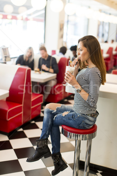Woman in diner Stock photo © boggy