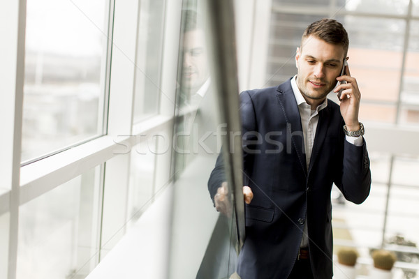 Businessman having phone call in the office Stock photo © boggy