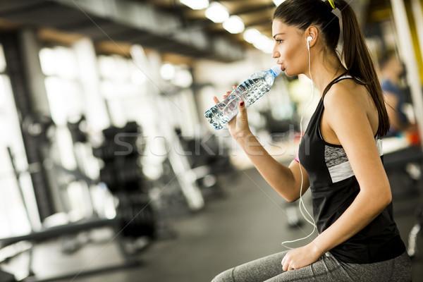 Anziehend Sport Trinkwasser Sitzung ruhend Stock foto © boggy