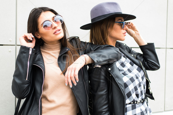 Two beautiful young women posing in town fashionably and stylish Stock photo © boggy