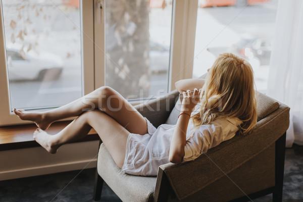 Genç kadın poz kadın iç çamaşırı pencere oda kadın Stok fotoğraf © boggy