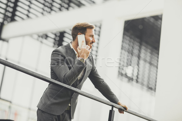 Young businessman calling on mobile phone at outdoor Stock photo © boggy