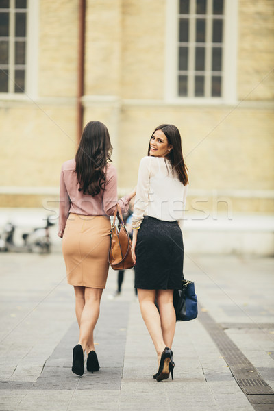 Two young women in high heels walking down the street Stock photo © boggy