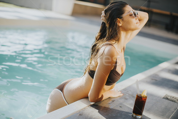 Pretty young woman on the poolside Stock photo © boggy