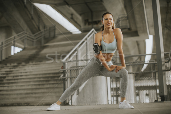 Pretty young woman having exercise in the urban environment Stock photo © boggy