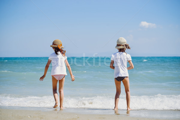 Cute little girls on the beach Stock photo © boggy