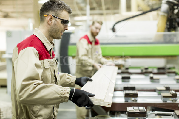 Young men working in furniture factory Stock photo © boggy