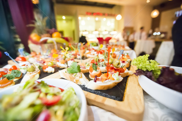 Díszített vendéglátás bankett asztal különböző étel Stock fotó © boggy