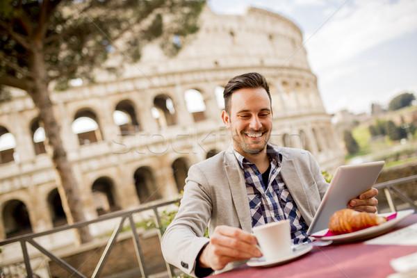 молодым человеком сидят Кубок кофе Рим Италия Сток-фото © boggy