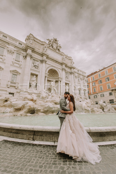 Young wedding couple by Trevi fountain in Rome Stock photo © boggy