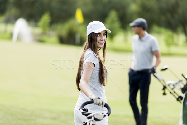 Fiatal pér játszik golf fű sport pár Stock fotó © boggy