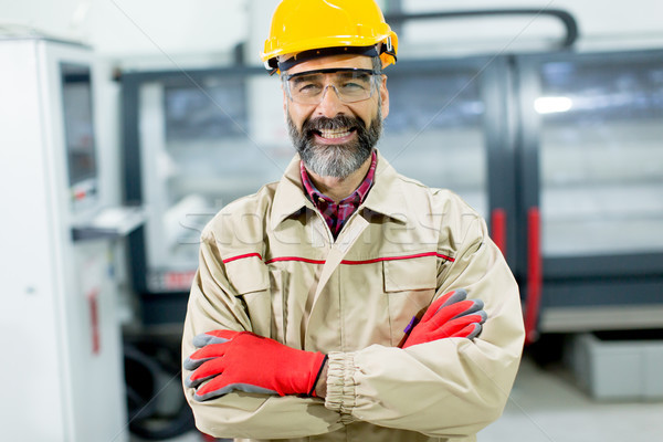Stock photo: Portrait of middle-aged engineer in factory