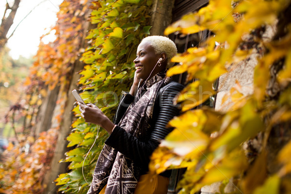 Stock photo: Young black woman with mobile phone