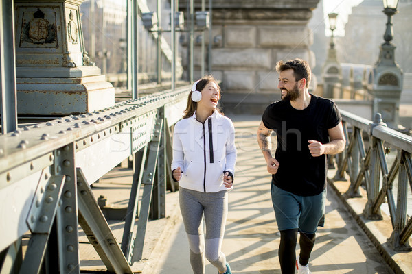 Couple jogging on Chain Bridge in Budapest Stock photo © boggy