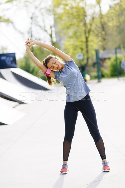 Young woman having exercise in the park Stock photo © boggy