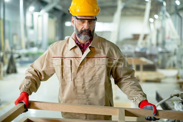 красивый зрелый человек рабочих мебель завода современных Сток-фото © boggy