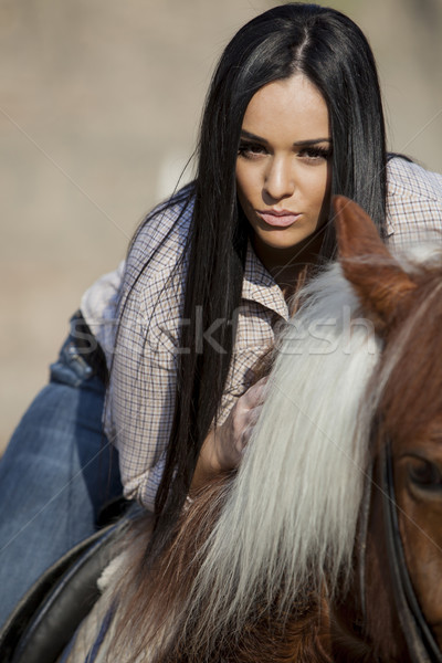 Girl on horse Stock photo © boggy