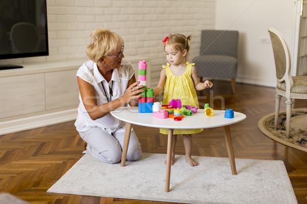 бабушки играет мало внучка комнату домой Сток-фото © boggy