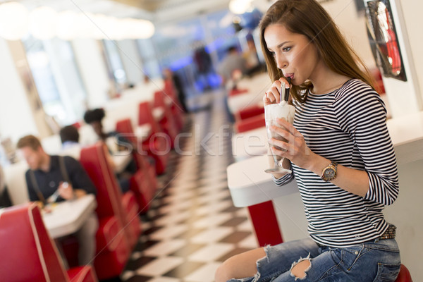 Woman eating in diner Stock photo © boggy