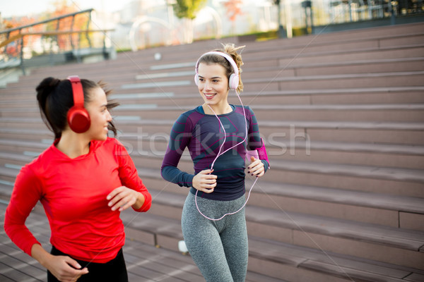 Young women running in urban area Stock photo © boggy