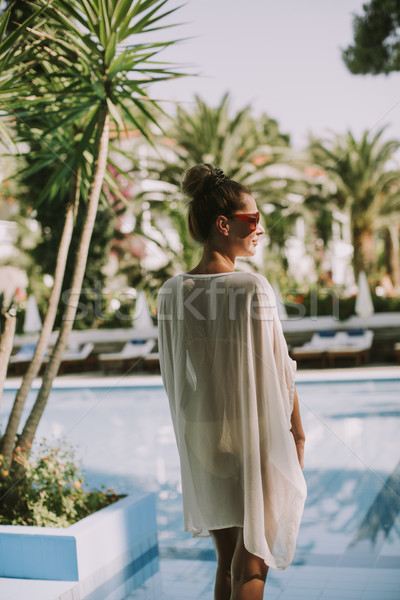 Young woman standing next to the swimming pool Stock photo © boggy