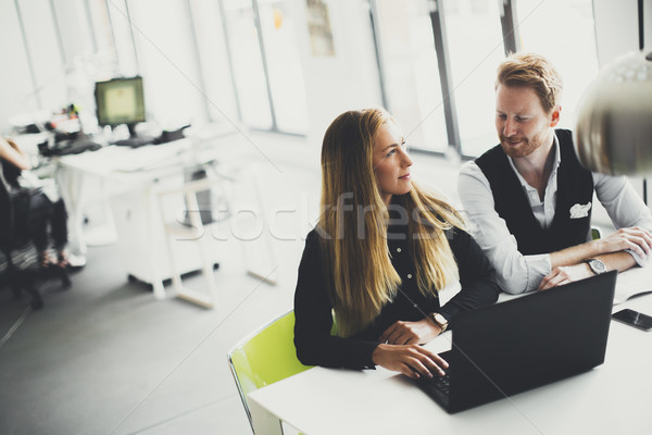 Stock photo: Young business people are in the office and working together