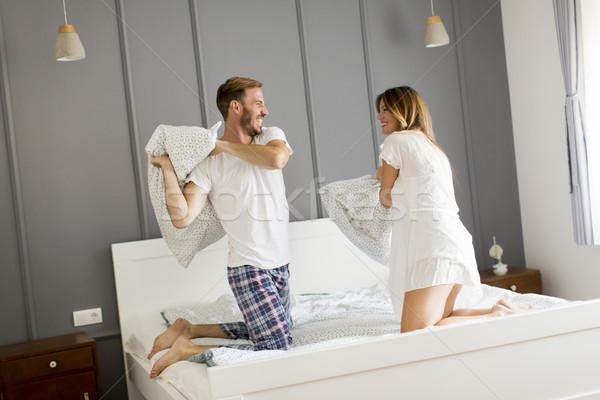 Yastık kavgası yatak ev çift Stok fotoğraf © boggy