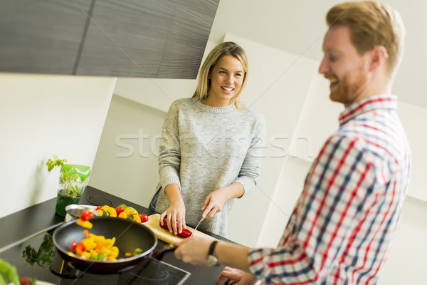Couple cooking together in the kitchen at home Stock photo © boggy