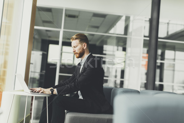 Young redhair man working in the office Stock photo © boggy