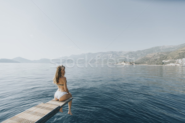Pretty woman relaxing on the yacht on sea at sunny day Stock photo © boggy