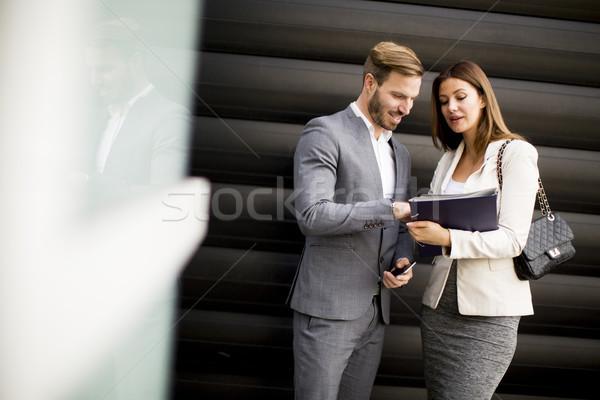 Giovani uomini d'affari parlando documenti outdoor business Foto d'archivio © boggy