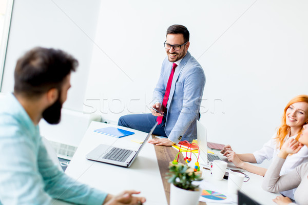 Stock photo: Business people around table during staff meeting